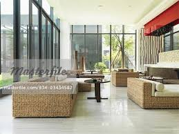 sunroom wicker furniture. Wicker Furniture In Large Modern Sunroom - Stock Photo