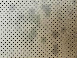 to clean perforated leather car seats
