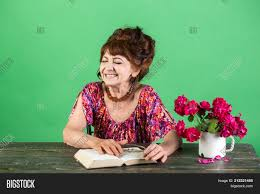 happy old lady or grandmother writer and poet granny read fairytale old woman reading