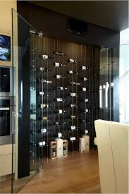 modern glass doors a closer look of the interior of the vancouver wine cellar with floating wine racks and