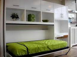 murphy bed desk with cabinet shelving storage from ikea also small bedroom solutions