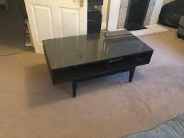 ikea hemnes dark brown wooden coffee table with glass top and storage