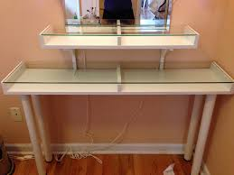 diy narrow makeup vanity table with makeup storage under glass top and white wooden base ideas