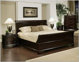 black high gloss finish oak wood storage bed frame with end table and headboard bookcase in red painted bedroom interior as well as queen wood beds plus black painted bedroom furniture