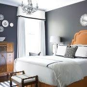 gray and orange bedroom. bedroom - grey walls, orange accents, black \u0026 white linens. if only i gray and