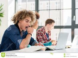 student sitting at desk side view. Plain Sitting Side View Portrait Of A Funny Student Yawning In Front Book While  Sitting Down At Desk The Classroom Modern College Or University With Student Sitting At Desk View U