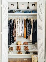 belongings in a small closet with the proper level of organization take a tour of how ine organized her whole wardrobe in a small space closet