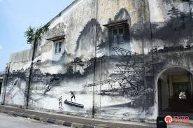 evolution starting as a tin mining town ipoh has evolved and grew rapidly to what it is today however it still retains its heritage and culture essence  on mural wall art ipoh with artist ernest zacharevic leaves his mark in ipoh for art of oldtown