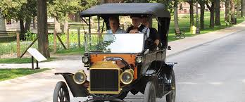 people driving a ford model t on a country road our american cousins define vintage cars