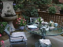 deck wrought iron table. This Charming Small-space Deck Features A Wrought Iron Table, Potted Plants And Table