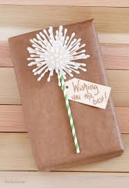 Use q-tips and a fun straw to make your own DIY Dandelion Gift Wrap