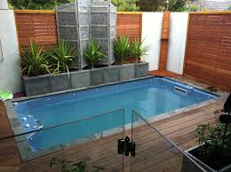 ... comfy small backyard pool with soothing greenery and wood clad fences  ...