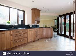 Limestone Flooring In Kitchen Limestone Flooring And Glass Patio Doors In Large Modern Kitchen