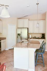 i know it wasn t awful but it just felt very blah to me the cabinets with the off white color and the glaze just made me feel like they used to be