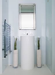 modern pedestal sink bathroom contemporary with bathroom mirror glossy houseplants avant garde faucet