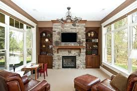 hanging a flat screen tv over a gas fireplace this marvelous stone fireplace has a wooden