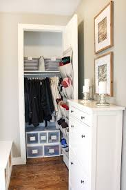 mud room shoe storage and organized coat closet