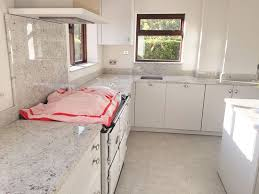 image of small kitchen with colonial white granite countertops