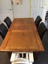 harveys solid oak toulouse extending dining table with 4 dark brown darcy chairs