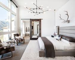Inspiration for a rustic master carpeted bedroom remodel in Salt Lake City  with white walls