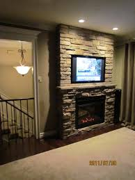 our own project built in flat screen tv and cultured stone fireplace
