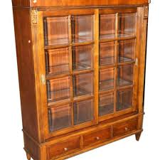 A Ethan Allen Walnut Finish 2 Door Bookcase With Slidingm02