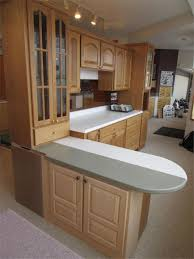 Maple Kitchen Cabinet Acrylic Top L Shaped Musser Bros Inc