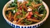 balsamic tossed pasta with fresh tomato  arugula  and mozzarella
