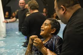 malachi 10 smiles after being baptized during the 2017 convention of jehovah s witnesses in