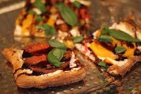 Drizzle warm tart with balsamic glaze and scatter with basil leaves.
