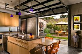 interior garage doorKitchen with Private Courtyard outside Glass Garage Doors  Modern