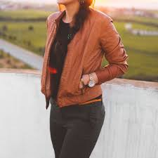 woman wearing brown leather jacket and black pants pose photoshoot person pants