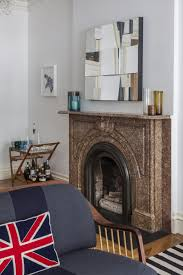 view in gallery brown marble fireplace in an eclectic space