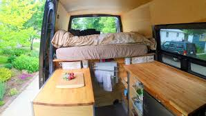 view in sprinter van sitting in front swivel seat looking back ikea countertops on either