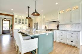 white kitchen cabinets with oil rubbed bronze cup pulls dark blue green