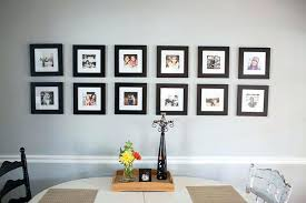 black picture frames wall. Wall Frame If Looking For A Gallery With Uniform Look Check Out This Lovely Display Featuring Two Neat Rows Of Photos In Black Frames Picture H
