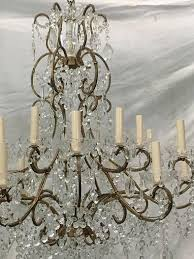 a large italian circa 1920s gilt metal and crystals chandelier with 18 lights original