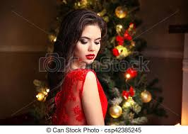 beauty makeup elegant brunette woman portrait in red dress over tree lights background happy new year winter holiday home party
