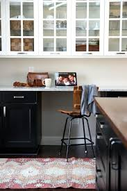 source House Tweaking Kitchen features black and white Ikea kitchen  cabinets Ikea Ramsjo lower