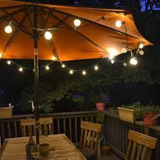 sunbrella outdoor light fixtures globe solar powered garden parasols string lanterns seating lighting porch stand decorative wooden patio umbrella lights