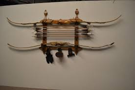 this is a western look bow holder measures 23 wide x 24 1 4 high holds 6 arrows with 3 pegs 165 00