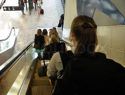 people on escalator. people on a escalator going down at station | stock photo colourbox