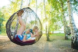 Hanging Swings: Why You Should Consider a Pod, Hammock or Basket Swing for  Your