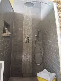tile iridescent glass mosaics in a vertical strip behind the shower head for a waterfall effect