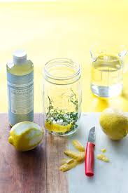 Peel the lemons and mix with the thyme: Use a peeler or knife to cut the  peel from the lemons and scrape off as much of the inside white part as  possible.