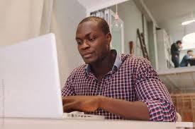 academic lance writing jobs in nairobi work from home black man laptop