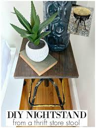 completed picture of easy diy nightstand in corner of guest bedroom with plant on book and