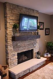 stone accent wall for a fireplace and a tv