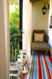 homegoods rugs eclectic balcony and area rug bold colors bright colors decorative pillows elephants handrail lantern metal railing outdoor curtains outdoor