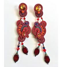 red chandelier earrings with purple and turquoise highlights